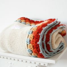 Crochet inspiration ~ Love the neutral colored blanket with the splash of color on the edging detail.  Neat way to fix an old, frayed edge blanket too!