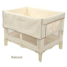 Arm's Reach Co-Sleeper Original Bassinet  Our twins sleep in this original sized co-sleeper together. Can't tell if they really LIKE it, as sometimes they just don't like sleeping, hahaha. But it certainly is convenient for the bedroom and you can fit two infants at once in it.