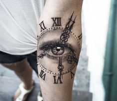 Clock with Eye tattoo by Niki Norberg
