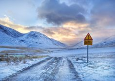 The roads in Iceland aren't that bad...what did that sign say? Akureyi, Iceland - Photo by Trey Ratcliff  #treyratcliff at www.StuckInCustom... - all images Creative Commons Noncommercial.