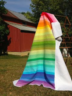Rainbow Stripes - made with one Jelly Roll & solid wide borders - Pretty!