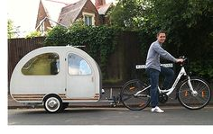 A mini caravan you can tow with a bike! Inside are a twin bed, 19 inch tv, bookshelf, electric tea kettle and mini bar.