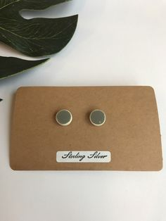 A personal favourite from my Etsy shop https://www.etsy.com/uk/listing/497917254/small-round-dark-grey-stud-earrings