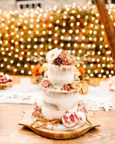 A naked cake free of excess frosting lets the fun details on the outside shine. Take inspiration from this creation: fresh and dried florals adorn the layers while a side of pomegranates add beautiful color. See more rustic wedding cake, decor, and dress ideas at rusticweddingchic.com 📸: @ellelilyphoto Wedding Cake Rustic, Wedding Cakes, Chocolate Drip Cake, Two Tier Cake, Rustic Wedding Inspiration, Drip Cakes, Wedding Cake Designs, Wedding Desserts, Tiered Cakes