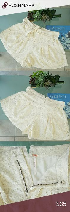 NWT FREE PEOPLE LACE SKORT IVORY Beautiful all over lace shorts skort with Side Pockets low waist decorative belt with hoops for placing. Front jeans cut zipper and hook closure. Small ears cut  waistband in back. Pleats in front and back for an additional flirty flare. Fully lined.68% cotton,32% polyester. Free People Shorts Skorts