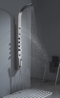 "www.vanityforless.com B-156  Contemporary Shower and Body Massage Jets  70 3/4"" x 4 1/2""     Turn your ordinary shower into a home spa with a shower panel. Installation is easy with only a hot and cold water connect and fast mounting on wall-attached brackets.     Unit Includes:  Hand held shower head  3 adjustable body massage jets  Stainless Steel Column"