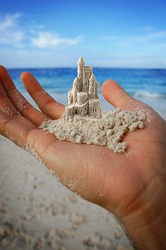 oooh! what about a teeny tiny castle? (This was created by photoshop, but makes me want to see if it can be made...will need to bring along a toothpick or dental instruments the next time at the beach).