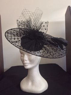 Pillbox hat with velvet polka dot tulle circle . Swarovski crystals,feathers and Chiffon rose trim. Can be worn to the side or to the front.