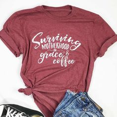 Surviving Motherhood on Grace and Coffee design on a maroon. Also if at the @dallasmarket  today stop by and see us. We are floor 12 booth 4416 by Starbucks. {Website link in BIO} . ___ #bible #biblev