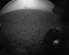 In this image from NASA TV, shot off a video screen, one of the first images from the Curiosity rover is pictured of its wheel after it successfully landed on Mars. REUTERS-Courtesy NASA TV-Handout