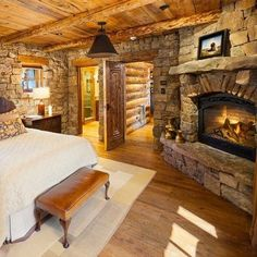 Rustic lodge bedroom interior with stone walls and fireplace. home · kitchen · rustic lodge interior decorating ideas Log Cabin Bedrooms, Lodge Bedroom, Log Cabin Homes, Rustic Bedrooms, Cozy Bedroom, Bedroom Ideas, Log Cabins, Bedroom Designs, Dream Bedroom
