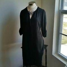 WHBM....BEAUTIFUL CUT DESIGN ...DRESS ...EXCELLENT CONDITION. ..NWT ...BRAND NEW ...NO FLAWS ...BEAUTIFUL  ...true to its size and color ...size 14...WIDE LOOSE FEEL could fit size 16 ...2 pic up close ...WIDE LOOSE FEEL ..for comfort  ...pullover ...dress ...3/4 sleeves  ...button down half way  ...button closing on sleeve ...V opening front  ...cut out design front ...MTRL. ...adding soon ...LENGTH. ...adding soon White House Black Market Dresses