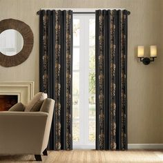 """Give your room a new look with the Madrid window panel. The panel is made of luxurious black faux silk fabric with chain-stitch embroidery in a beautiful gold scroll medallion motif. This energy saving panel is lined and feature interlining with fleece material to retain the heat or keep cool air from escaping your room. The top treatment is a back tab and rod pocket details for multi hanging options and will fit up to 1.25"""" diameter rod.  The panel comes in 84"""" and 95"""" length."""