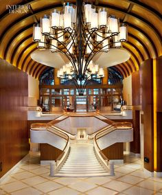 A grand staircase at the St. Regis Sanya Yalong Bay Resort in Sanya, Hainan, China by DiLeonardo International, a 2013 Interior Design Giant.