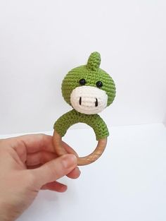 crochet dinosaur patterns Crochet dinosaur (dragon) wooden rattle teether made with love for your baby! Crochet plush toy for month's babies. Newborn Toys, Baby Toys, Newborn Crochet, Crochet Baby, Crochet Gifts, Crochet Toys, Crochet Dinosaur Patterns, Pram Toys, Eco Friendly Toys