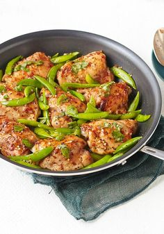 Chicken & Snap Pea Skillet — Chicken thighs are skillet-cooked in sun-dried tomato vinaigrette until golden brown and juicy, then tossed with crisp-tender snap peas and fresh basil.