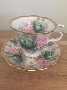 Royal Albert Jade Summer Bounty Teacup and Saucer - Floral porcelain teacup and saucer with gold gilt. Tea Cup Set, My Cup Of Tea, Tea Cup Saucer, Vintage Cups, Vintage China, Vintage Tea, Antique Dishes, Vintage Dishes, China Tea Sets