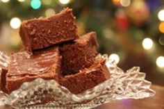 Easy Christmas Fudge: 3 cups sugar, 5 oz can evaporated milk, 1 1/2 sticks (3/4 cup) butter, 1 7-oz.jar marshmallow creme, 1 12-oz. package chocolate chips, 1 cup chopped nuts (optional).