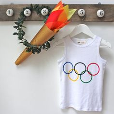 Winter Olympics Crafts. Get ready for the Sochi games with fun DIY projects like a torch, an olive wreath, and an Olympic rings T-shirt for kids! #everydayfun