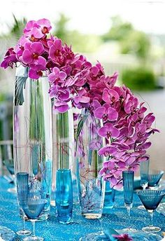 pretty cascading orchid arrangement.  Maybe can do an ombre one similar to the ombre tulip arrangement? :)