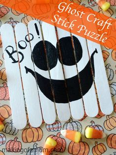 Ghost Craft Stick Puzzle - easy Halloween Craft simply made with craft sticks and paint! A fun craft and then Halloween puzzle.