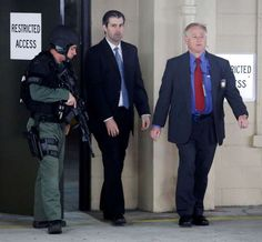 MISTRAIL.......Michael Slager, center, walks from the Charleston County Courthouse under the protection from the Charleston County Sheriff's Department during a break in the jury deliberations in his trial Monday, Dec. 5, 2016, in Charleston, S.C. Slager, a former North Charleston police officer, is charged with murder in the shooting death last year of Walter Scott.