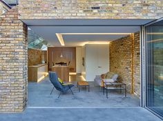 The modern side extension is the mainstay of small inner city architecture practices, particularly in London. Designed by Coffey Architects House Extension Design, House Design, Side Extension, Extension Ideas, Hidden House, Bungalow Renovation, House Extensions, Kitchen Extensions, Polished Concrete