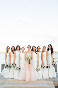 White bridesmaids dresses idea - matching long white bridesmaids dresses with bateau neckline + bride in a blush sheath, strapless sweetheart neckline wedding dress {Ashley Tilton Photography}