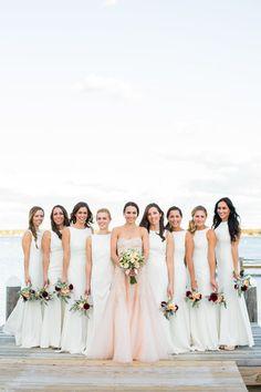White bridesmaids dresses idea - matching long white bridesmaids dresses with bateau neckline + bride in a blush sheath, strapless sweetheart neckline wedding dress {Ashley Tilton Photography}