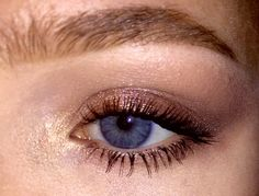 Sparkly copper eye makeup.