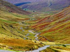 """""""Duddon Valley - Hardknott Pass from Wryness Pass"""" - photo by Lawrence Peregrine-Trousers (Boo), via Flickr;  Looking down west end of Wrynose Pass. Hardknott Pass is in the far distance snaking up to the right.  (England)"""