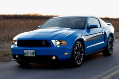 Ford Mustang Gt 2012 California Special! Picture it in yellow with the top down and ME behind the wheel.  Yeah man!