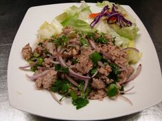 Larb Kai - Ground chicken blended with lime juice, chili oil, and onion from Pataya Cafe in Pasadena , CA