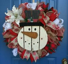 This beautiful burlap Snowman wreath is filled with the spirit of Christmas. Measuring approximately 25 inches with a depth of 9 inches. Filled with red burlap mesh and a natural burlap mesh, accented with 4 types of gorgeous burlap ribbon and a Stunning pontsettia. This is a made to order item. Made to order items can take 2-3 weeks to ship. Made to order items may have slight variations from photo.