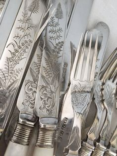 This is an exquisite set of 10 knives and 10 forks in perfect condition. As with many of these old sets of silver, they were kept for the most