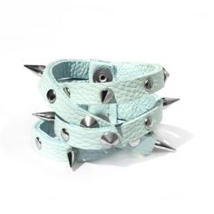 Hey Stud! Embellishment is a key trend this season and this studded pastel wrap around bracelet is an easy way to nod to the Punk revival. A pastel blue leather strap easily wraps around the wrist and can be adjusted to suit, while the gunmetal silver studs and spikes add a rock edge. Length: 19cm. Width: 4.5cm.