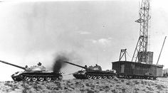Soviet medium tanks T-62 pulls the rig geological reconnaissance party. Aktogay and the Kazakh SSR, approx 1980-th year.