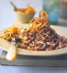 Hippocrene Cooks!: Moujadara (Lentils and Rice with Crispy Onions) I think I'm going play with some of the spices from this recipe. http://www.foodnetwork.com/recipes/emeril-lagasse/lentils-with-bulgur-wheat-and-caramelized-onions-moujadara-with-burghul-recipe/index.html