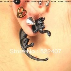 Free shipping three-dimensional fluorescence leopard leopard cat small sharp nail the long tail earrings for men and women  $13.00