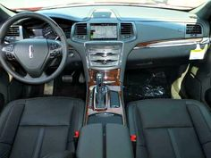 Interior: New 2014 Lincoln MKS EcoBoost. $52,717 AWD. Ruby Red Metallic