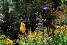 Gazing globe holder made of shovels. Jill's garden by vickie_s, via Flickr