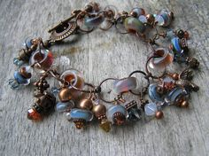Blue Charm Bracelet of Boro Lampwork Beads & Copper. $109.00, via Etsy.