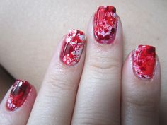 blood splatter nail art, i have seen some tutorials where they do this kind of splatter with a straw but I still haven't tried it out :)