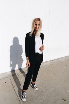 Black suit, chucks & vintage glasses. Via Mija