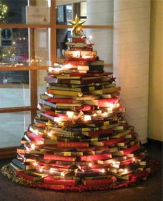 Christmas tree with books. Great use of books! Improvisation at its best & early seasons' greetings! #in