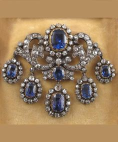 Victorian Sapphire and Diamond Brooch - oval shaped sapphire - surround of cushion shaped diamonds - in silver and gold - suspending five graduated sapphire and diamond clusters Diamond Brooch, Diamond Jewelry, Jewelery, Silver Jewelry, Sea Glass Jewelry, Silver Earrings, Cameo Jewelry, Diamond Bar, Silver Brooch