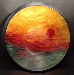Dyed Big Leaf Curly maple bowl with sunset motif. The variation in the color tones are totally the result of the grain of the wood. The dye was wiped on. No painting or other embellishment. Handmade woodturning.