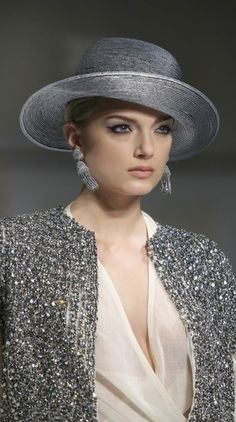 Oscar de la Renta...I have always thought of hats only being worn during the day but this looks gorgeous and it..... works!