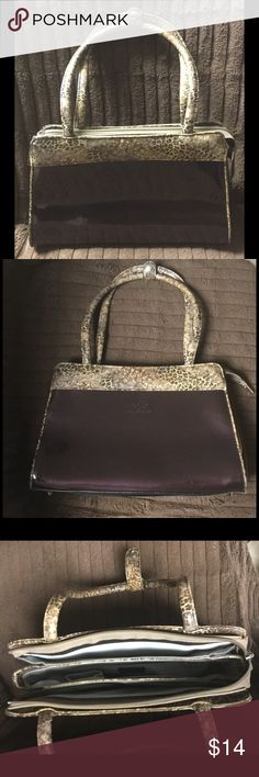 """Brown Animal Beijo Handbag Lovely footed purse with animal print on handles and trim. Purse has snap on handle for security. The inside has three large sections the middle has zipper pocket, open section, and pocket for cell. The outside of purse has some scratches, while the inside is like brand new. Measures across the front 12"""" and 8 1/2"""" in height while the handles are 8"""" high. Item jn12 Beijo Bags Shoulder Bags"""