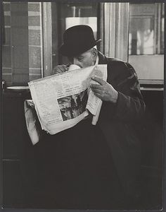[Man in Bowler Hat Reading Newspaper and Drinking Tea, London]